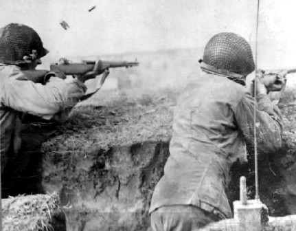 The clip ejecting from an M-1 Garand rifle in a period photograph.